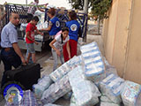 The distribution of aid to Syrian refugees in a camp in Erbil Core Cusick